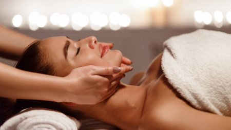 252558456-stock-photo-face-massage-young-woman-getting